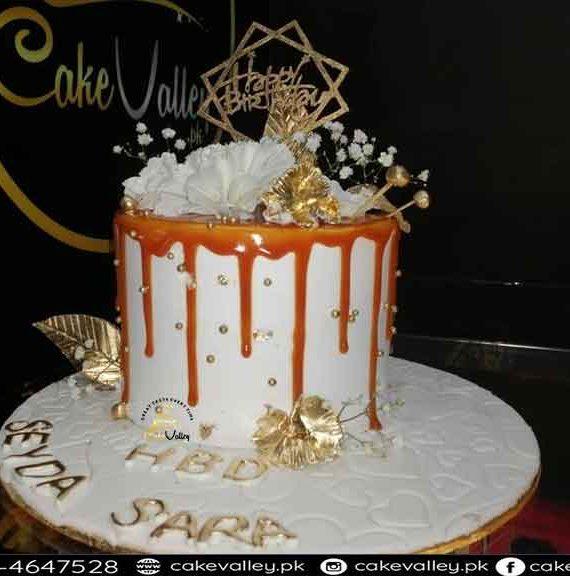 golden theme cake